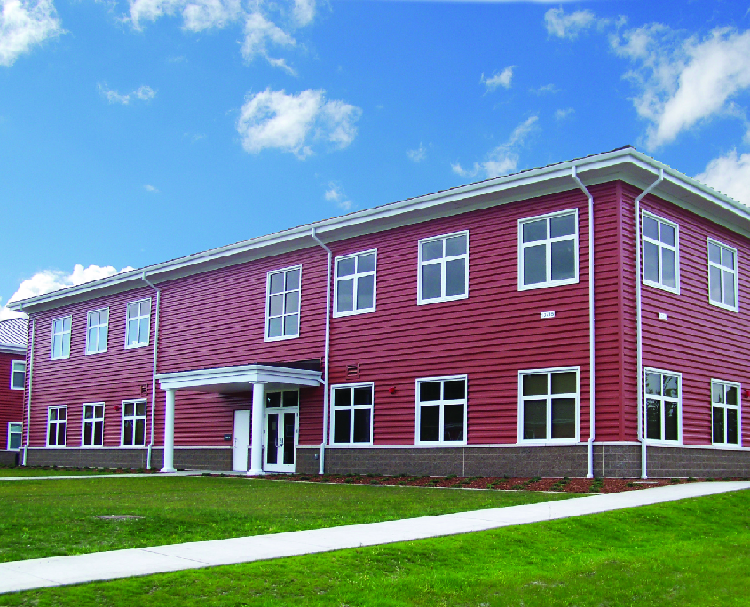 2-story red brick building with metal roofing