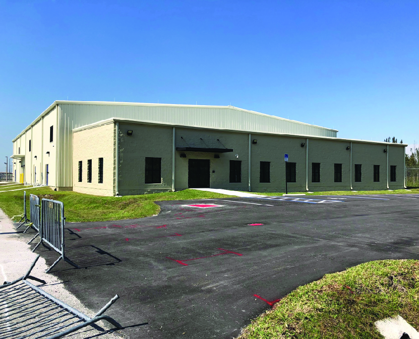 White pre-engineered metal building serving as a warehouse
